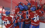 Montreal Canadiens' Josh Anderson is surrounded by teammates after scoring against the Vegas Golden Knights during overtime in Game 3