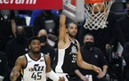Los Angeles Clippers forward Nicolas Batum, right, scores as Utah Jazz guard Donovan Mitchell watches during the second half in Game 6