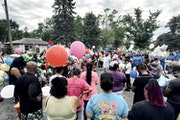 A balloon release was staged in Minneapolis where Dychaun Chew was hit by an SUV driver and killed.