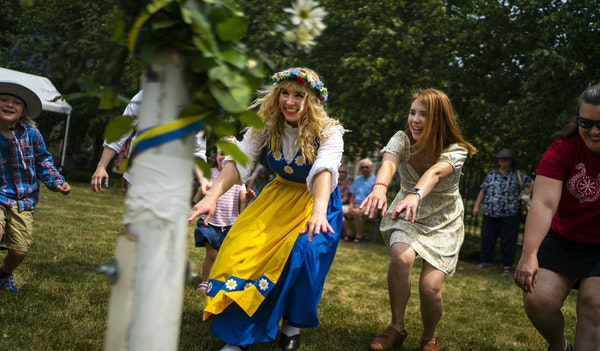 Sisters Natalie Redinger, center, and Heather Dewitt, center right, did a traditional circle dance at the American Swedish Institute on Thursday ,