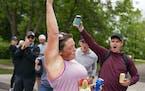 Melissa Cramton stopped to chug a free beer as she ran down London Rd during Grandma's Marathon on Saturday morning.    ] ALEX KORMANN • alex.korm