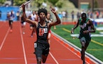 Ramy Ayoub (4) of Farmington, wins the Class 2A boys 4x400 meter relay ahead of Victor Lelinga, of Mounds View, right.
