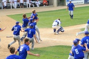 New York Mills baseball players rushed out of the dugout Wednesday to celebrate their dramatic 15-inning victory over Randolph in the longest game by