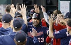 Nelson Cruz celebrates his two-run home run against the Rangers during the fourth inning