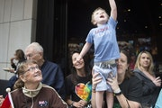 In this 2017 photo, families celebrate at the annual Twin Cities Pride parade-watching part. After a year without celebrations, the community is looki
