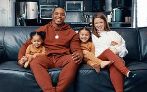 C.J. Ham and his wife, Stephanie, and their growing family.