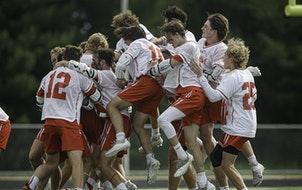 Benilde-St. Margaret's players celebrate their 16-6 victory over Prior Lake in the boys' lacrosse state championship game at Stillwater. Boys' l