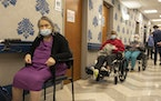 Nursing home residents wait in line to receive a COVID-19 vaccine at Harlem Center for Nursing and Rehabilitation, a nursing home facility, on Friday,