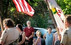 Duane and Mary Bonebrake stood at attention as the Princeton Scouts carried the American flag at the beginning of the Princeton Rum River Festival's