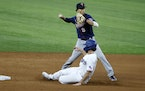 Minnesota Twins shortstop Andrelton Simmons (9) starts a double play as Texas Rangers Charlie Culberson, bottom, slides into second base to end the fi