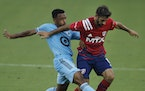 FC Dallas midfielder Facundo Quignon, right, tries to maintain ball control as Minnesota United midfielder Jacon Hayes defends during the first half
