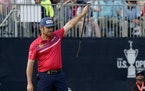 Louis Oosthuizen reacts to making his eagle putt on the 18th green during the third round of the U.S. Open