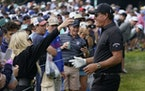Phil Mickelson hugs his wife, Amy Mickelson, on the seventh fairway during the second round of the U.S. Open Golf Championship, Friday, June 18, 2021,