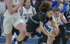 Hopkins' Amaya Battle battled for the ball with Wayzata's Alivia Arnebeck in a section final in March 2020.