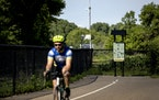 A cyclist rode past the point of the Midtown Greenway that abruptly ends at W. River Parkway before the near the Canadian Pacific railroad bridge over