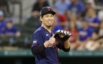 Twins starting pitcher Kenta Maeda gave a thumbs up during Sunday's game at Texas.