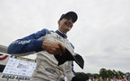 Alex Palou celebrated after winning an IndyCar race at Road America in Elkhart Lake, Wis.
