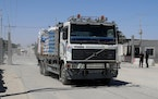 A truck carrying fruits and vegetables enters Gaza at the Kerem Shalom cargo crossing with Israel, in Rafah, southern Gaza Strip, Monday, June 21, 202