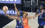 Napheesa Collier (left) and Sylvia Fowles (right) have been named to the U.S. Olympic women's basketball team.