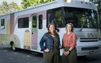 Maribeth Romslo and Kim Senn posed with the 1999 Winnebago they've started remodeling and call Winnie Cooper in Edina, Minn., on Monday, June 14, 20