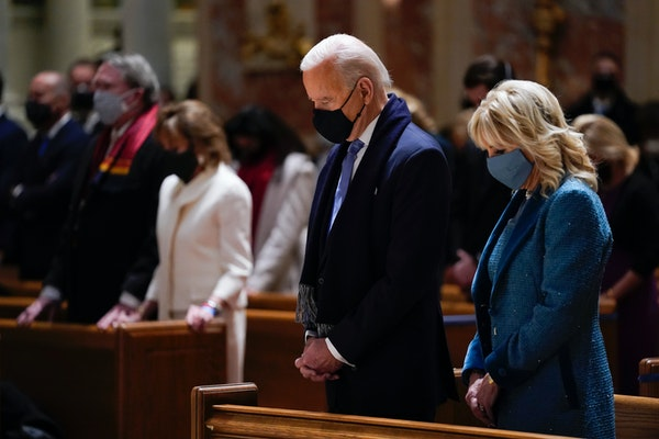 In this Wednesday, Jan. 20, 2021 file photo, President-elect Joe Biden and his wife, Jill Biden, attend Mass at the Cathedral of St. Matthew the Apost