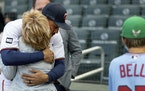 Minnesota Twins centerfielder Byron Buxton hugged Mike Bell�s mother Gloria during a Mike Bell Tribute before the start of the game.