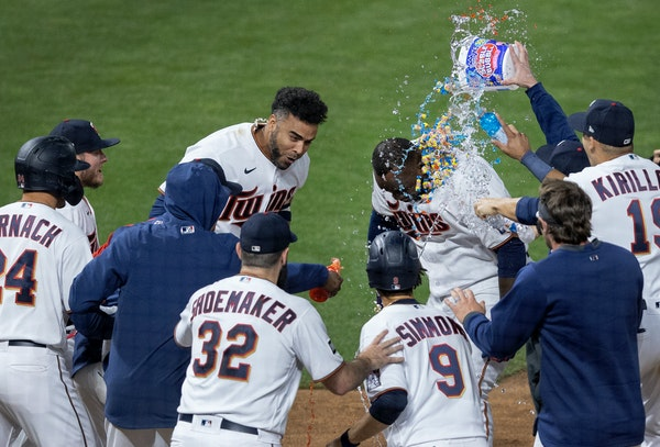 Miguel Sano was greeted at home plate by his teammates after his walk-off two-run homer ended the longest Major League Baseball game this season.