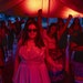 Students took to the dance floor for Saturday's Native Prom at Minneapolis South High School. Below, chaperone Milayka Downwind manned the entrance.