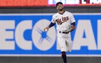 Byron Buxton reacted after making a catch in the fifth inning Monday night. He was playing with a broken pinky finger.