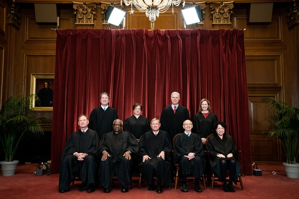 Members of the Supreme Court posed for a group photo on April 23, 2021. Seated from left: Associate Justice Samuel Alito, Associate Justice Clarence T