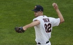 Minnesota Twins pitcher Bailey Ober throws against the Chicago White Sox in his major league debut in the first inning of a baseball game Tuesday, May