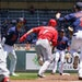 Eugenio Suarez of the Reds got caught between Twins Alex Kirilloff (19) and Jorge Polanco (11) trying to steal second base Tuesday at Target Field.