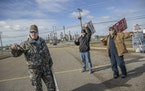 Members of Teamsters 120 shown picketing outside the Marathon Refinery in March.