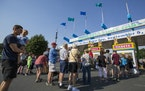 People line up at the main ticket booth on the first day of the 2016 Minnesota State Fair.  [Leila Navidi/Star Tribune] • leila.navidi@startribune.c
