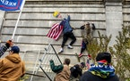 Supporters of then-President Donald Trump storm the U.S. Capitol in Washington on Jan. 6.