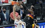Phoenix center Deandre Ayton, right, scores over Clippers center Ivica Zubac during the final second of Game 2