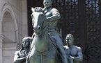 FILE — In this June 22, 2020 file photo, a statue of Theodore Roosevelt on horseback guided by a Native American man, left, and an African man, righ