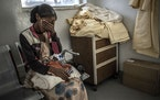 Tsalat Ashaber, weeps as she waits for doctors in Mekelle to operate on her 2-year-old daughter, who suffered a perforated abdomen during a government