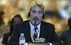 FILE - In this Tuesday, Aug. 16, 2016 file photo, founder of the first commercial anti-virus program that bore his name, John McAfee listens during th