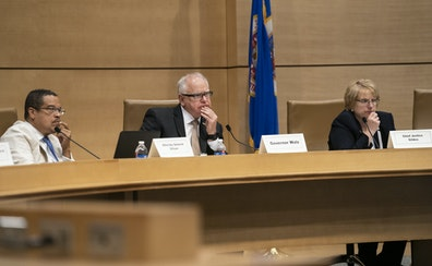 Attorney General Keith Ellison, Gov. Tim Walz and Chief Justice Lorie Skjerven Gildea listened during a Board of Pardons hearing.