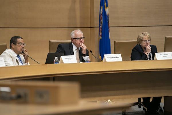 Attorney General Keith Ellison, Gov. Tim Walz and Chief Justice Lorie Skjerven Gildea listened during a Board of Pardons hearing. RENÉE JONES SCHNEID