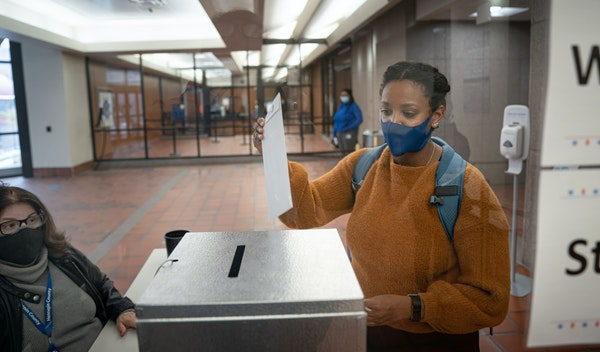 A voter dropped her ballot in the ballot box at the Hennepin County Government Center before the 2020 election.