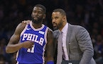 Nets assistant coach Ime Udoka (right, shown with the 76ers' James Ennis III in a 2019 photo when Udoka was a Philadelphia assistant) has been hired