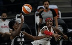 Lynx center Sylvia Fowles (34) fought off Atlanta forward Cheyenne Parker for a rebound Wednesday. Fowles was unstoppable, finishing with 26 points an