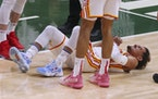 Hawks guard Trae Young laid on the court after drawing a hard foul from the Bucks during the first half of Game 1 of the Eastern Conference finals Wed