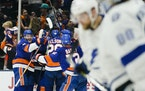The Islanders celebrated an overtime goal by Anthony Beauvillier after Game 6 of a Stanley Cup semifinal Lightning goaltender Andrei Vasilevskiy left