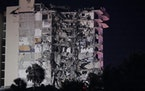 A partially collapsed building is seen early Thursday, June 24, 2021, in the Surfside area of Miami, Fla.