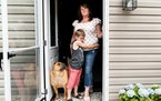 Kimberly Burnworth at her mobile home in Bruceton Mills, W.Va., with David, her son, and their dog, Dozer Diesel, on June 11, 2021. Many mobile home o