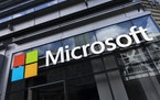This May 6, 2021 photo shows a sign for Microsoft offices in New York. Microsoft has unveiled the next generation of its Windows software, called Wind