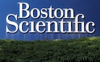 A Boston Scientific logo is displayed in Massachusetts in July 2010. (AP file photo.)